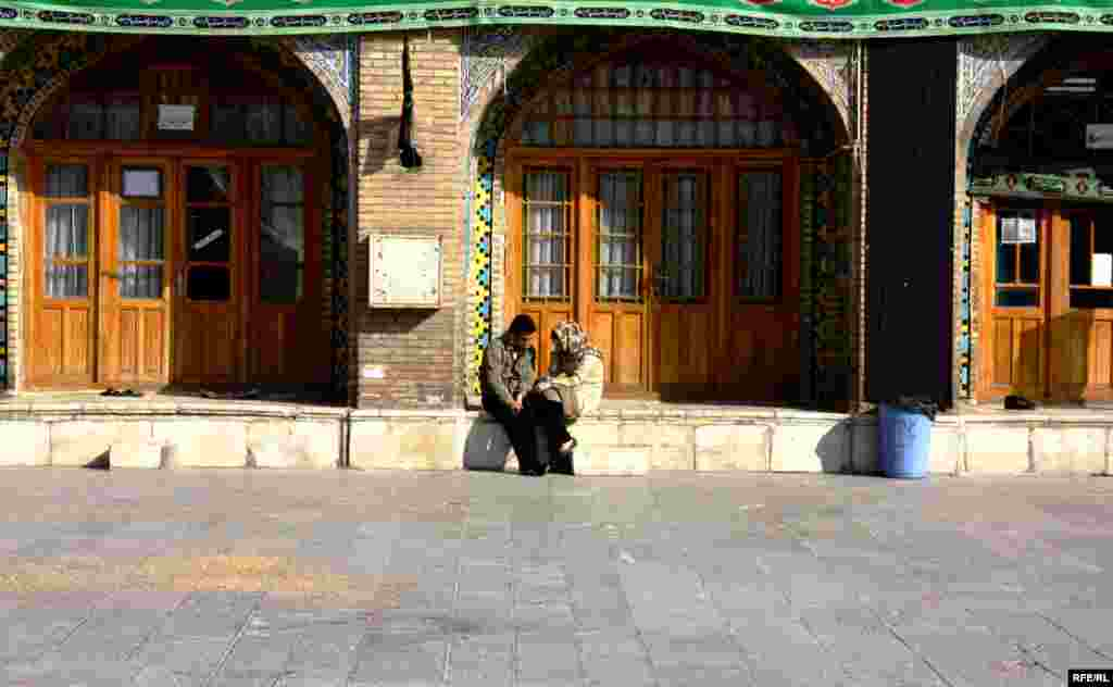 A young couple chats outside the Imamzade Ismayil Mausoleum. - (Photos by RFE/RL Azerbaijani Service correspondent Abbas Atilay)
