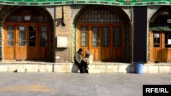 Two young people chat outside the Imamzade Ismayil Mausoleum in Qazvin, Iran. (file photo)