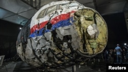 The reconstructed wreckage of the MH17 airliner is displayed after the presentation of the final report into the crash of July 2014 of Malaysia Airlines Flight 17 over Ukraine in October 2015.