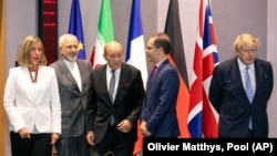 From left, European Union foreign policy chief Federica Mogherini, Iranian Foreign Minister Javad Zarif, French Foreign Minister Jean-Yves Le Drian, German Foreign Minister Heiko Maas and British Foreign Secretary Boris Johnson pose for a photo in Brussels on May 5, 2018.