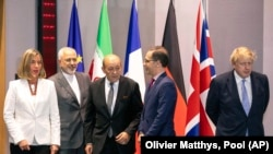 From left, European Union foreign policy chief Federica Mogherini, Iranian Foreign Minister Javad Zarif, French Foreign Minister Jean-Yves Le Drian, German Foreign Minister Heiko Maas and British Foreign Secretary Boris Johnson pose for a photo during a