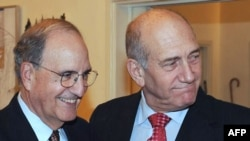Israeli Prime Minister Ehud Olmert (right) meets with U.S. peace envoy George Mitchell in Jerusalem.