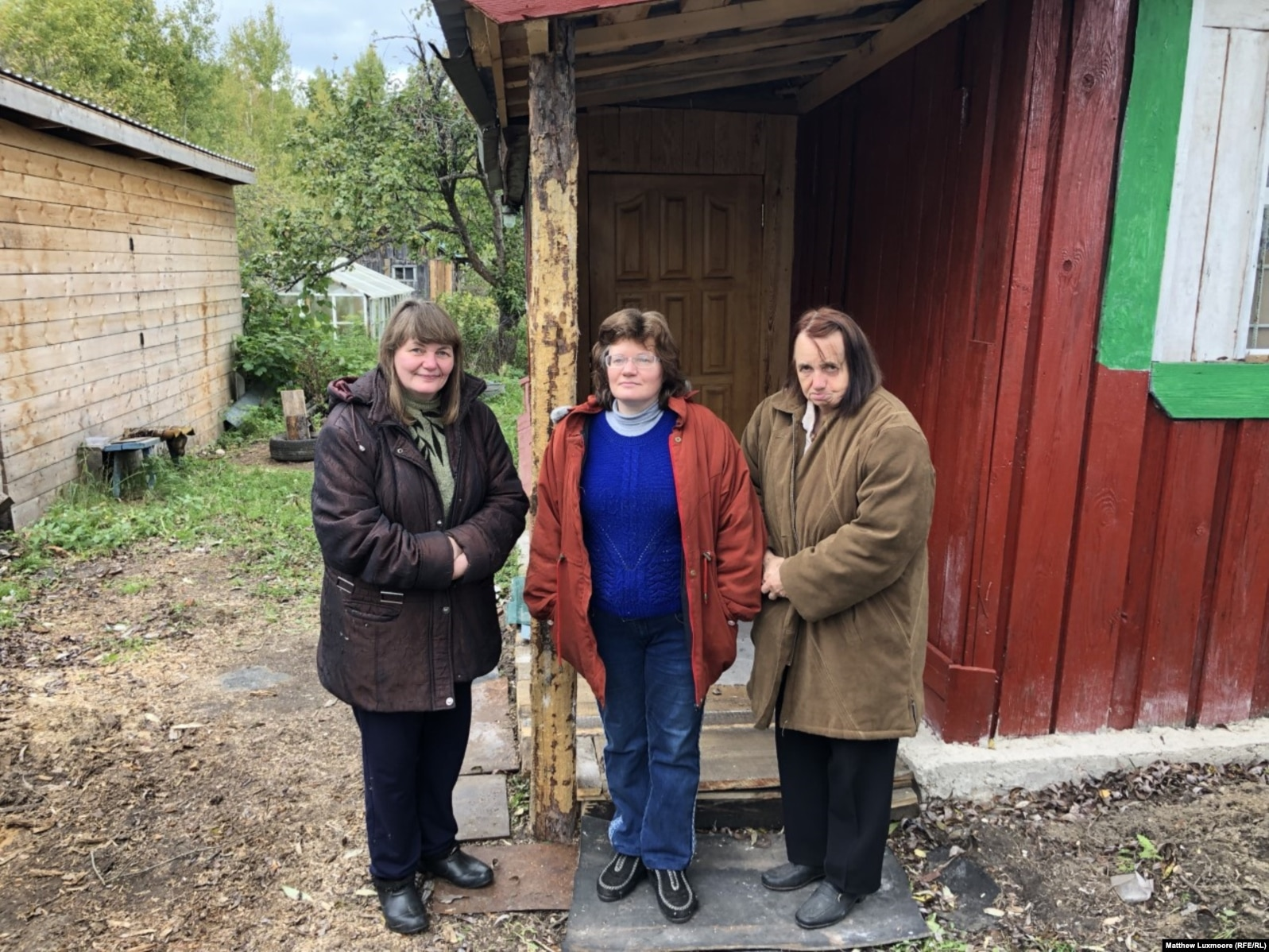 Yelizaveta Mikhailova (right) shares her monthly pension of the equivalent of about $230 with her two adult daughters, Nina (left) and Vladislava, and partly relies for sustenance on whatever food the nearby forest will provide.