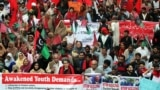 Pakistani students shout slogans during a protest to demand the government a rollback of education budget cuts and the reinstatement of student elections in Lahore on November 29.