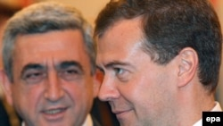 Medvedev and Sarkisian at a meeting in June