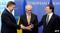 EU President Herman Van Rompuy (center) and European Commission President Jose Manuel Barroso (right) welcome Ukrainian President Viktor Yanukovych ahead of an EU-Ukraine Summit in Brussels earlier this year.