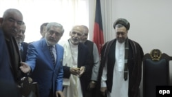 Afghan President Ashraf Ghani, second right, stands with, from left, Vice President Abdul Rashid Dostum, Chief Executive Dr. Abdullah Abdullah and Muhammad Mohaqiq, the deputy to Abdullah Abdullah, in 2014.