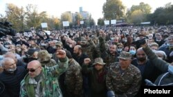 Demonstrators at a rally in Yerevan demand the resignation of Armenian Prime Minister Nikol Pashinian. November 13, 2020.