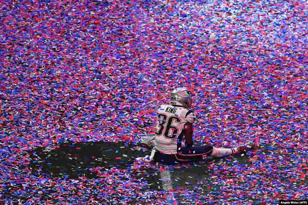 American football player Brandon King of the New England Patriots sits in confetti on the playing field after his team won the Super Bowl against the Los Angeles Rams in Atlanta, Georgia, on February 3. (AFP/Angela Weiss)