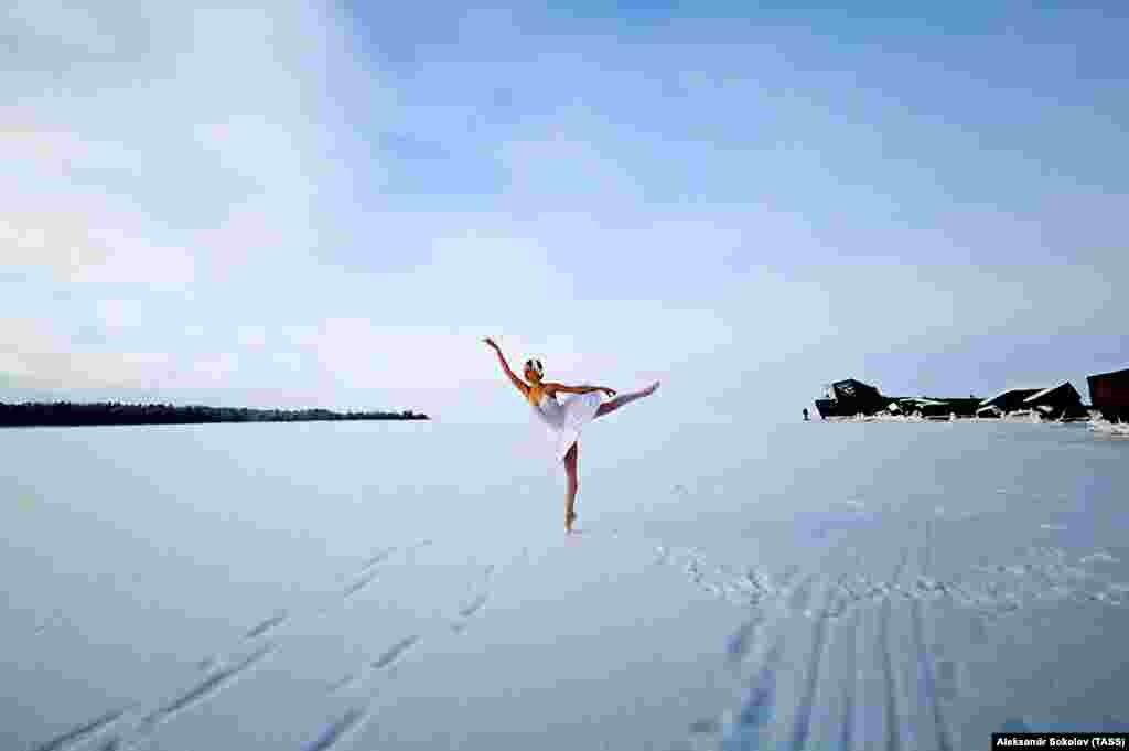 A ballerina dances on the frozen Batareinaya Bay of the Gulf of Finland in Russia's Leningrad region. (TASS/Alexander Sokolov)
