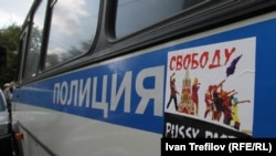 A flyer calling for freedom for the members of Pussy Riot pasted onto a police van outside the Khamovnichesky court building in Moscow, 17Aug2012