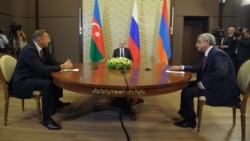 Russia - President Vladimir Putin (C) hosts talks between his Armenian and Azerbaijani counterparts, Serzh Sarkisian and Ilham Aliyev, in Sochi, 10Aug2014.