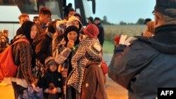 Группа мигрантов с Ближнего Востока у хорватской границы, 29 сентября 2015 года.