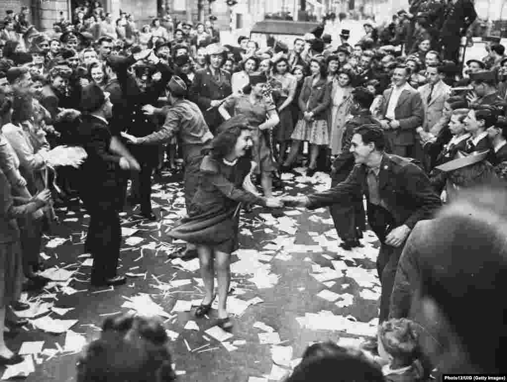 British women dance with U.S. soldiers in London on May 8, the day after Nazi Germany surrendered to the Allies.
