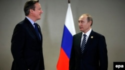 Președintele Vladimir Putin cu premierul David Cameron la summitul G20 summit la Antalya, în 2015