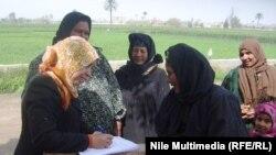 Египеттік әйелдер референдумда дауыс беріп жатыр. 14 қаңтар 2014 жыл.