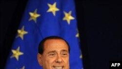 премиерот Силвио Берлускони.