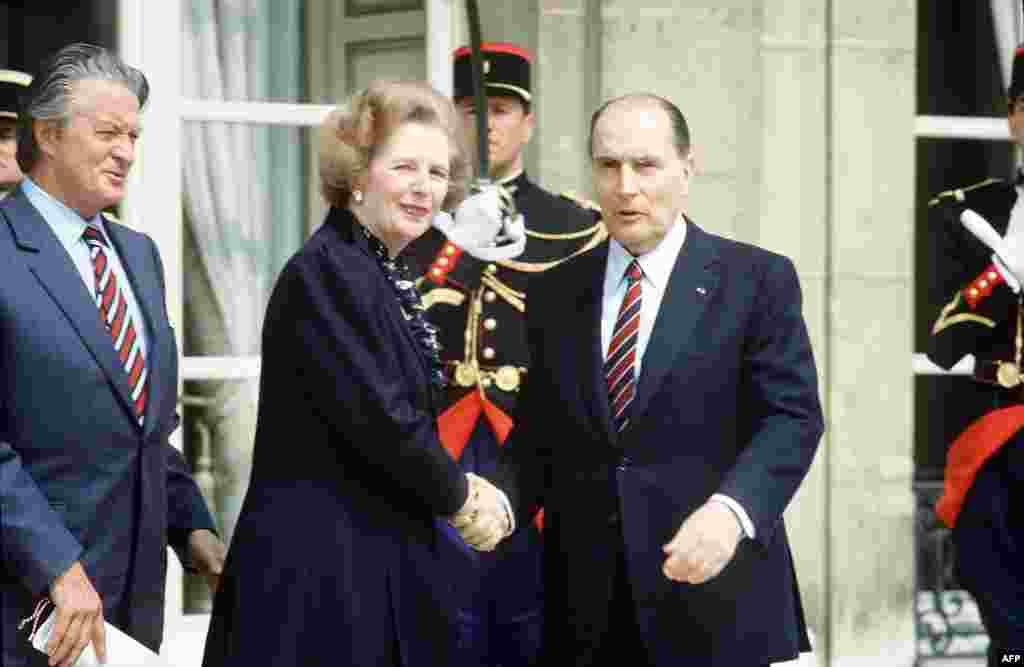 French President Francois Mitterrand and Foreign Minister Roland Dumas (left) welcome Prime Minister Margaret Thatcher in front of the Elysee Palace in Paris in May 1984.