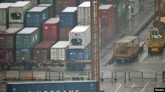 Shipping containers ready and waiting at the Shanghai port.