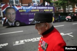 A pensioner passes in front of the U.K. Independence Party's pro-Brexit campaign bus in London.