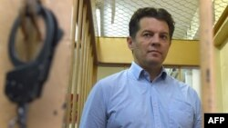 Ukrainian journalist Roman Sushchenko stands inside the defendants' cage during a hearing at a court in Moscow in November 2016.