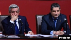 Armenia - President Serzh Sarkisian (L) and Prime Minister Tigran Sarkisian attend a conference of the ruling Repubican Party in Yerevan, 15Dec2012.