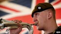 FILE: A bugler from the Royal Anglian Regiment plays members of the British Armed Forces take part in a service of commemoration taking place at the Afghan National Army Officers Academy (ANAOA) in Kabul.
