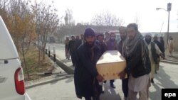 People carry the coffin of a victim of a suicide bomb attack that targeted a volley ball match, in Paktika, November 24, 2014