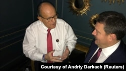 Rudolph Giuliani (left) is shown in Kyiv meeting with Ukrainian lawmaker Andriy Derkach in an undated photo.
