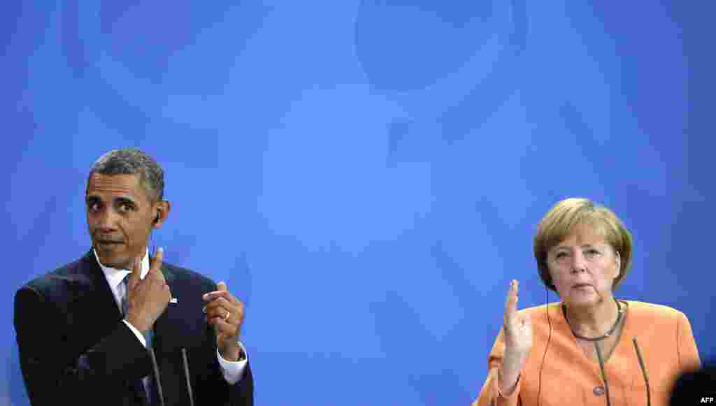 U.S. President Barack Obama and German Chancellor Angela Merkel gesture during a press conference at the Chancellery in Berlin in June 2013.
