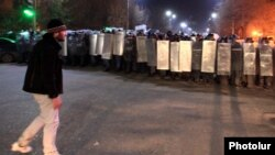 Armenia - Mnatsakan Aleksanian (L) is puctured during a demonstration in Gyumri, 15Jan2015.