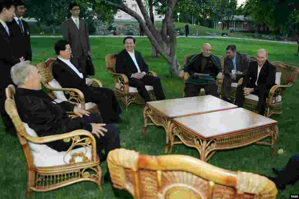 (Seated from left) Kazakh President Nursultan Nazarbaev, Chinese President Hu Jintao, Mongolian President Nambaryn Enkhbayar, Afghan President Hamid Karzai, and Russian President Vladimir Putin during a meeting of the Shanghai Cooperation Organization in Bishkek, Kyrgyzstan, in 2007. Afghanistan and Mongolia are observers of the security and economic bloc.