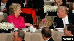 U.S. Democratic presidential nominee Hillary Clinton (left) and Republican presidential nominee Donald Trump at a recent dinner in New York.