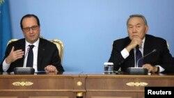 Қазақстан президенті Нұрсұлтан Назарбаев пен Франция президенті Франсуа Олланд (сол жақта). Астана, 5 желтоқсан 2014 жыл.