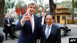 U.S. Secretary of State John Kerry (left) arrives with acting Foreign Minister Bui Thanh Son at the Ministry of Foreign Affairs, before their meeting in Hanoi on Januray 13.