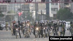 Iranian riot police on motorcycles patrol a Tehran street during protests in June 2009.