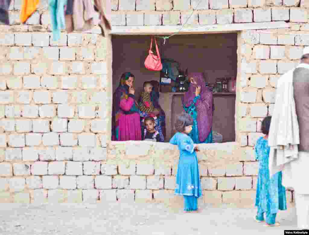 Latifa (left), a mother of five, was evicted from her home in Darra Adam Khel, a town in northwest Pakistan, where she had lived for nearly 20 years.