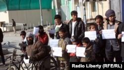 Участники акции протеста против ИГ и Талибана. Кабул, 23 января 2015 года.