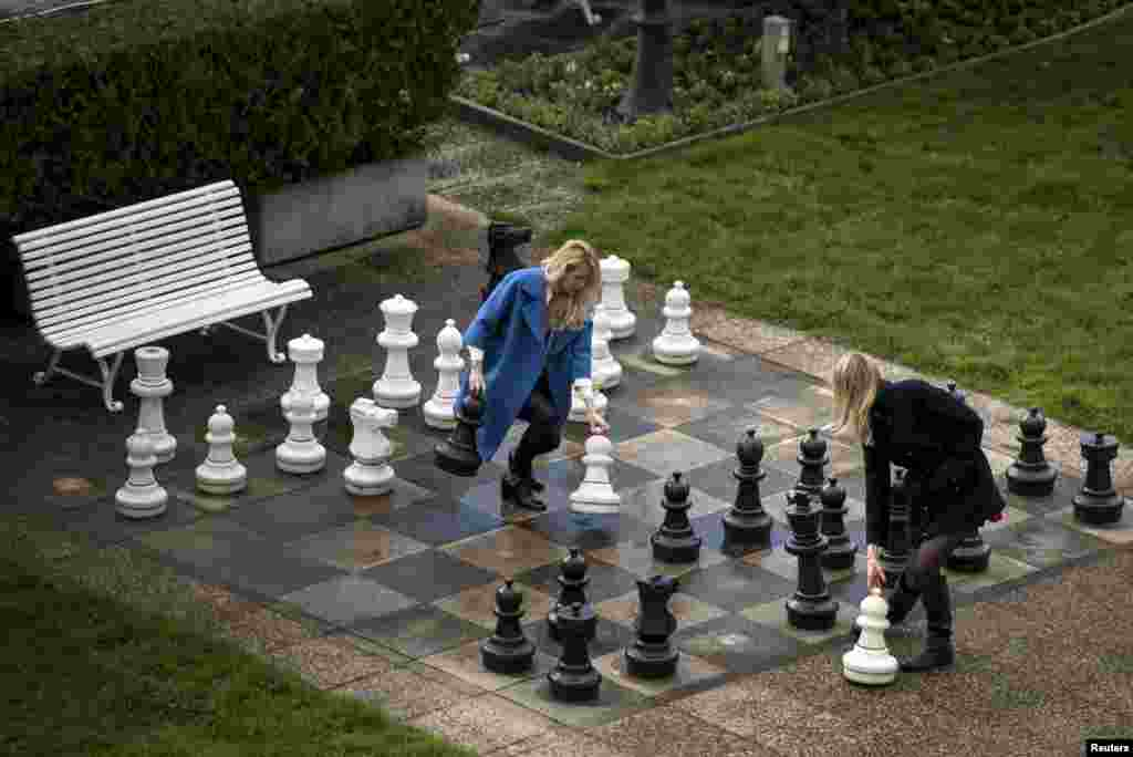 Russian journalists play a game of giant chess in a courtyard at the Beau Rivage Palace Hotel in Lausanne, Switzerland, on April 1 as they wait for news in the ongoing Iran nuclear talks. (Reuters/Brendan Smialowski/pool )
