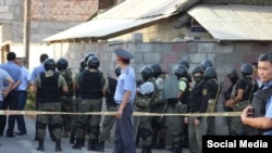 Kyrgyz security forces at the site of the shoot-out in Bishkek that killed four