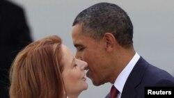 Australia - U.S. President Barack Obama kisses Australian Prime Minister Julia Gillard as he arrives in Canberra, 16Nov2011