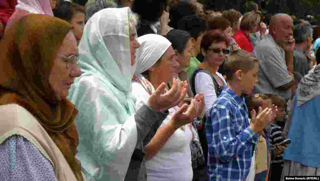 Some people prayed as the trucks drove by.