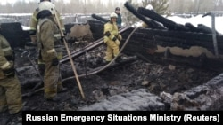 Russian Emergencies Ministry members work at the site of the fire on January 21.