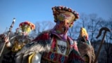 Masked dancers, known as Kukeri, take part in a parade during the 28th International Festival of Masquerade Games -- 'Surva 2019' -- in the town of Pernik, Bulgaria, January 27, 2019.