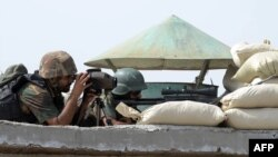Pakistani soldiers take up positions at post during a military operation against Taliban militants in the town of Miranshah in North Waziristan on July 2.