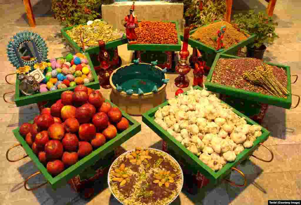 Fruit, eggs, spices, and sweets make up a Norouz display in the Iranian capital, Tehran.
