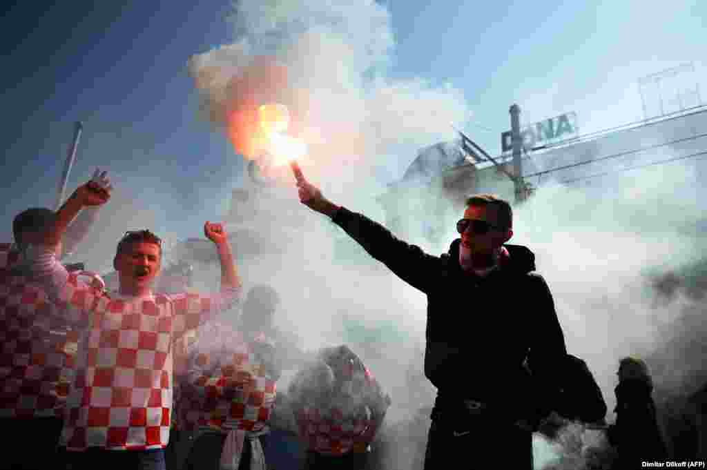 Croatian soccer fans shout slogans prior to their team's World Cup 2014 qualification match against Serbia in Zagreb. (AFP/Dimitar Dilkoff)