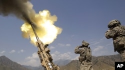 A 155mm round is fired from a Howitzer at insurgents at Forward Operating Base Bostick in Kunar Province on July 8.