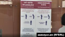 A sign at Yerevan's airport alerts passengers to the coronavirus risks.