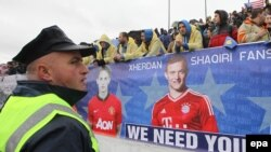 A banner with portraits of Bayern Munch's Xherdan Shaqiri (right) and Manchester United's Adnan Januzaj, both of Kosovo origin, is displayed prior to the international friendly soccer match between Kosovo and Haiti.
